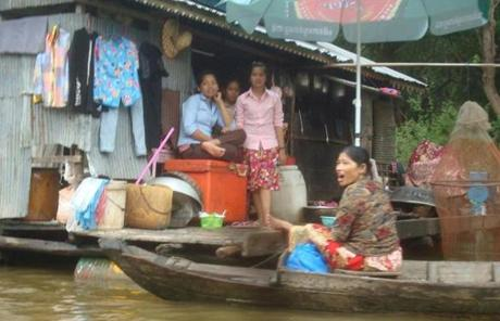 Neighbors visited a floating house in Kampong Phluk.