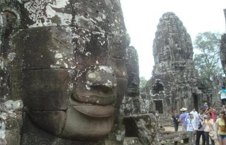 Stone faces at Angkor's Bayon temple, a world-class attraction not far from the impoverished aquatic village of Kampong Phluk.
