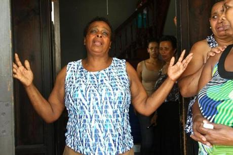Maria Teixiera, 58, distraught over the shooting death of her son, Safiro Furtado, in the South End, was surrounded by relatives and friends in the entryway of her home. July 17, 2012.