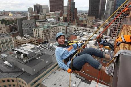 THE PLUNGE: Mix 104.1's Kennedy Elsey ready to rappel down the face of a hotel in a fund-raiser for Special Olympics athletes from Massachusetts, Hyatt Regency Boston on July 20