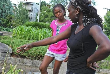 Jhana Senxian, right, in the garden with her neighbor Kaori Tate, left. The 10-year-old, a gardener and gifted track runner, became one of the people Jhana relies on for help.