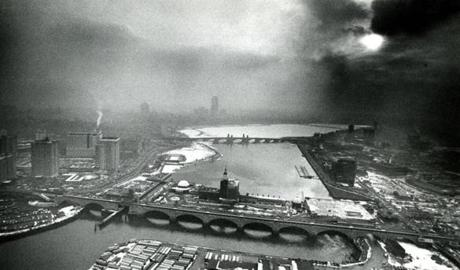 Photo taken at 3:50 p.m. on February 5, 1970 looked toward the southwest over the Science Museum and towards the Prudential Tower which is obscured in the center background. Visibility was reduced in the metropolitan area by a combination of natural haze and sulfur dioxide. It mixed with soot and flyash to capture water droplets which magnified their visibility.