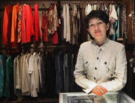Oksana Pan, the owner of Deja Vu, a consignment shop in Newton Highlands.
