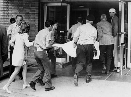 July 31, 1973: A body was brought to the morgue at Massachusetts General Hospital after the crash. MGH set up a crisis counseling center for relatives and friends of the Delta plane victims. The crisis service was established in 1942 after the devastating Cocoanut Grove fire and provided 24-hour access to trained psychiatrists at no charge. Dr. Aaron Lazare, director of outpatient psychiatry at the hospital, urged family members to avail themselves of this service in the coming days.