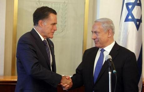 Romney shook hands while meeting with Israeli Prime Minister Benjamin Netanyahu, the centerpiece of his trip.