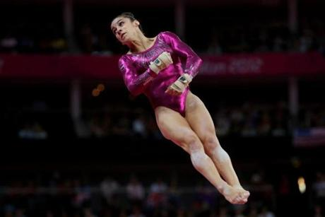 Needham's AlyRaisman competed on the vault.