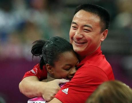 Gabrielle Douglas of the United States hugged coach Liang Chow after her uneven bars routine.