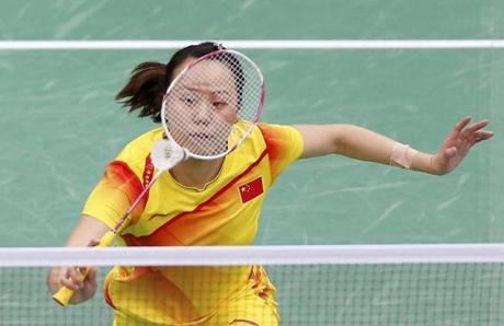 China's Zhao Yunlei played against Indonesia's Mohammad Ahsan and Bona Septano during their mixed doubles badminton semifinals match.