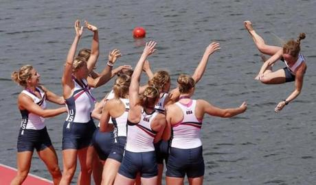 Team USA celebrated winning the gold medal at the victory ceremony after the women's eight finals rowing event. The team included Erin Cafaro, Zsuzsanna Francia, Esther Lofgren, Taylor Ritzel, Meghan Musnicki, Eleanor Logan, Caroline Lind, Caryn Davies, and Mary Whipple.