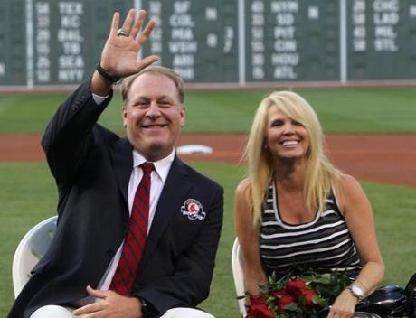 Boston, MA - 08/03/12 - Boston Red Sox Hall of Fame inductee pitcher Curt Schilling and wife Shonda during the on the field ceremony. The Boston Red Sox took on the Minnesota Twins at Fenway Park. - (Globe Staff Photo / Barry Chin), section: Sports, reporter: abrahamp, slug: 04Twins-Red Sox, LOID: 5.0.2146152969.