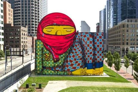 Check out the Os Gemeos mural in Dewey Square.