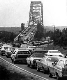 July 15, 1972: Driven by the heat to the cooler climate of Cape Cod, motorists paid their dues in the traditional traffic jam as the Cape beckoned beyond the Sagamore Bridge. New England had just experienced its hottest week of the year and there was no relief in sight with temperatures in the 90s expected to continue. Nine miles of traffic were backed up on Rte. 3 by mid-afternoon.