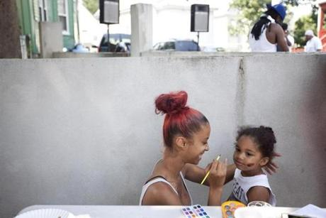 There were burgers and dancing and face-painting at a block party on Norton Street this summer that was organized by Tal, a magnet for trouble.