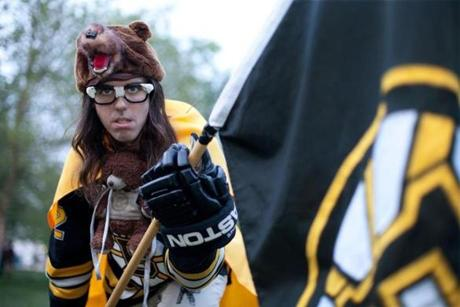 Duncan Devlin showed off his Boston Bruins costume. Devlin dresses up in a costume consisting of decorated pants, a Bruins jersey, a Bruins cape, a Bruins teddy bear, a bear hat, a large Bruins flag, and rollerblades.