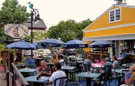 The outdoor tables at Bubala's By The Bay offer a prime vantage on the passing scene of Commercial Street.