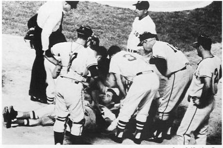 August 18, 1967:  Boston Red Sox player Tony Conigliaro was surrounded by teammates after being hit on the head by a fourth-inning fastball from Jack Hamilton of the California Angels. When Conigliaro dropped in the batter's box after being hit, he never stirred. The rush from the Red Sox dugout started with Manager Dick Williams.