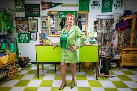 Boston Celtics fan Agnes Nobile, 60, stood in her consignment store named