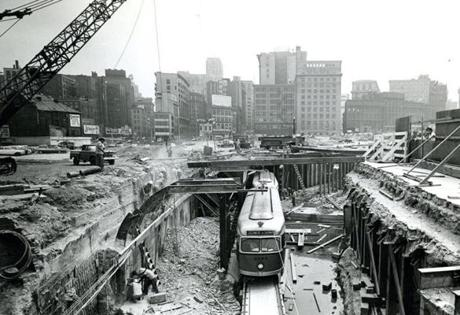 August 13, 1963: A Lechmere car had a brief moment in the sun as it passed through an opening in the tunnel near Haymarket Square, where workers tried to complete a new underground route.