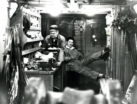 January 8, 1971: Foreman Timothy O'Donnell (left) and lineman Francis Fitzgerald (right) were inside the wire car. They were on their way to a section of the subway system where the overhead catenary system, as the trolley wires were called, were in need of repair. The present day Green Line is entirely powered by overhead catenary.
