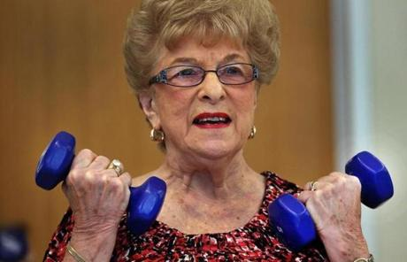 Elaine Rosen, 80, lifted weights in a class at Orchard Cove in Canton.