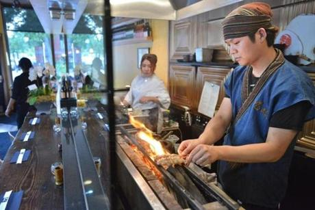 Executive Chef Sho Inoue cooks an order on the special charcoal grill Yakitori Zai in the South End. JOSH REYNOLDS FOR THE BOSTON GLOBE (Living/Arts,first)