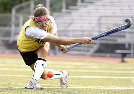 Andover's Jaclyn Torres let go with a shot during field hockey practice in Andover.