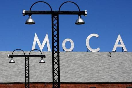 North Adams, MA - 09/27/08 - Parking lot lighting and a rooftop sign for MASS MoCA makes its own art against a September sky. (Globe Staff/Mark Wilson; section: Travel; slug: 01northadams ; reporter: unknown ) *** SLUG: 01northadams 3 of 11 CREDIT: Mark Wilson/Globe Staff ONLINE CAPTION: The lighting in the parking lot and a rooftop sign make an artistic scene at MASS MoCA, one of the largest centers for contemporary visual and performing arts in the country. 21williamstown / OUTTAKe 1019