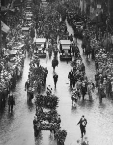 August 29, 1927:  The gigantic funeral cortege of Nicola Sacco and Bartolomeo Vanzetti marched over streets strewn with flowers from the North End to the Forest Hills Cemetery. The bodies of the two men lay in state at the Langone undertaking chapel at 383 Hanover St, North End, prior to the funeral procession and the two men were cremated at Forest Hills. Some of the floral pieces were so huge it required half a dozen men to carry them.
