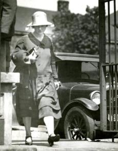 August 8, 1927:  Mrs. Rose Saco, wife of Nicola Sacco, leaves the Charlestown State prison after visiting with Arthur D. Hill, new defense counsel for the two men. Sacco and Vanzetti continued on a hunger strike that began July 16th.  Attorney Hill said he found the men