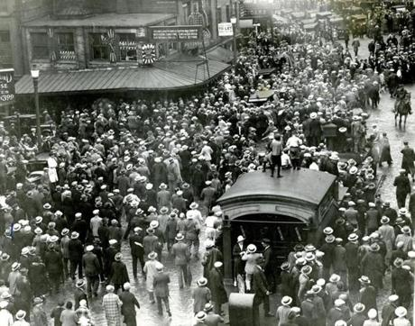 August 29, 1927:  Crowds estimated by police at more that 200,000 witnessed the funeral of Nicola Sacco and Bartolomeo Vanzetti. People gather in Scollay Square to watch the procession.