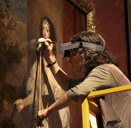 Rhona MacBeth, the Eijk and Rose-Marie van Otterloo Conservator of Paintings and Head of Paintings Conservation, makes final adjustments to the restoration.