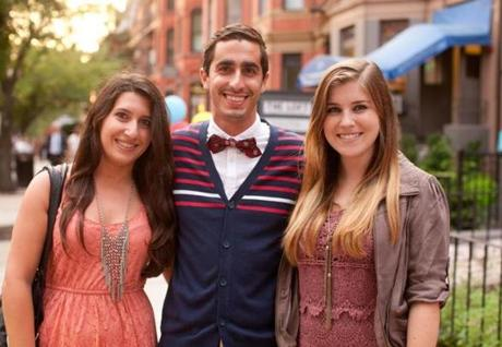 9/6/12 Boston, MA -- From left, Boston University students Ariel Ferrante, Chris Schretzenmayer and Julia Iglesias, all of Boston, pause for a photo on the way to the Marc Jacobs store during Fashion's Night Out along Newbury Street in Boston, September 6, 2012. Erik Jacobs for the Boston Globe
