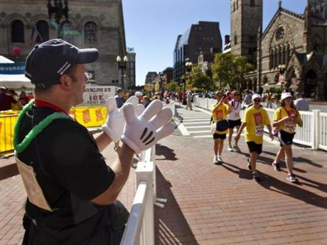 Boston, MA 9/9/12 Gary Bastarache (cq) of Bellingham who finished the walk in 6 1/2 hours cheering on other walkers at the finish line for the Jimmy Fund Walk in Copley Square on Sunday September 9, 2012.(Matthew J. Lee/Globe staff) slug: 10jimmywalk Section: metro reporter: