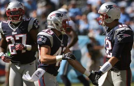 Tom Brady, right, congratulated members of the defense after a stop in the fourth quarter.
