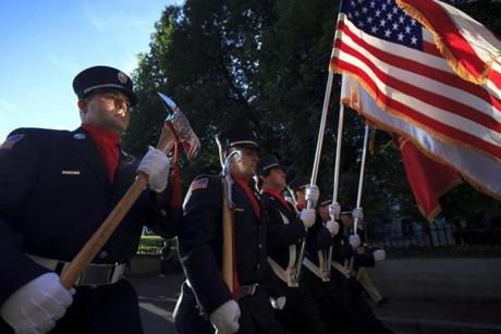 Boston, MA - 9/11/2012 - Members of the Professional Fire Fighters of Massachusetts, led by the Color Guard, processed toward Ashburton Park near the State House for the annual Massachusetts Fallen Fire Fighters Memorial Ceremony. Hundreds of uniformed first responders and supporters gathered for the event, which included a speech from Governor Deval Patrick and ceremony to honor the 343 fire fighters who died in the September 11, 2001 attacks. Topic: 12firefighters. Dina Rudick/Globe Staff.