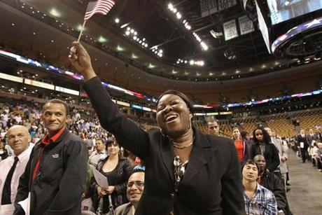 Boston, MA., 09/11/12, A naturalization ceremony was held at the TD Garden for 2,396 immigrants from 132 countries. Patience Osazuwa, cq, waves the flag when the name of her home country is called. It is Nigeria. Section: Metro Suzanne Kreiter/Globe staff