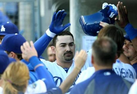 Adrian Gonzalez hit a home run in his first at-bat for the Dodgers after his trade.