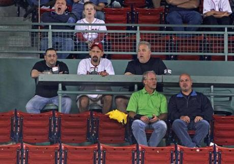 9-11-2012: Boston, MA: A fan yawns at upper left with some empty seats around his area as the Red Sox-Yankees rivalry continues. The Boston Red Sox hosted the New York Yankees in an MLB regular season game at Fenway Park. section: sports (Globe Staff Photo/Jim Davis