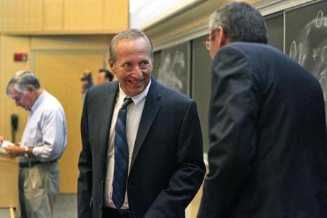 9-12-2012: Boston, MA: Two well known Harvard economists, Larry Summers (center) and Greg Mankiw (right) took part in a forum held on the campus of Northeastern University, talking about their views on the recovery and tax policy. The event was moderated by former Massachusetts governor Michael S. Dukakis (backround left). This photo was taken just after Summers arrived a little late for the event and he was saying hello to Mankiw. section: business (Globe Staff Photo/Jim Davis