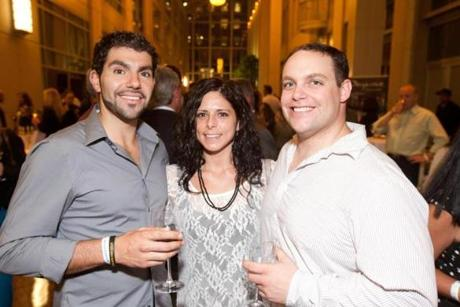 9/12/12 Boston, MA -- From left, Paul Pereira, Rochelle Bearup and Tony Aiuvalasit, all of Somerville at the Taste of the NFL Kickoff Party hosted by Davio's Northern Italian Steakhouse in Boston, September 12, 2012. Steve DiFillippo (of Davio's) in partnership with the Taste of the NFL and many of Boston's top chefs hosted the event with all proceeds benefitting the Greater Boston Food Bank. Erik Jacobs for the Boston Globe
