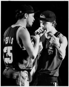 Mansfield, Ma 5/30/92 Marky Mark, pop singer from Dorchester (right) as his brother Donny Wahlberg singer in the pop group New Kids on the Block, announces to the crownd that Saturday was Marky Mark's birhtday. (he turned 21.). They performed before a sold out crowd at Great Woods Center for the Performning Arts Saturday nite. The day-long concert was sponsored by WXKS radio. Boston Globe Staff Photo/Jim WIlson. (This is availabl in color.) 25wahlbergonline *** SLUG: 25wahlbergonline 2 of 22 CREDIT: Jim Wilson/Boston Globe Staff file photo CAPTION: Mark Wahlberg (right) performing with his brother Donnie at Great Woods in Mansfield in 1992. Library Tag 02252007 Arts & Entertainment ----- 0930NKOTB