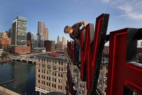 John Coyne of the Romero Electric Co. and co-workers checked out the W sign at 263 Congress St. in Boston. Sept. 17, 2012.