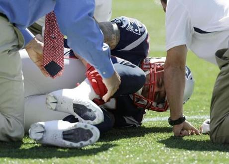 Aaron Hernandez held his right lower after the injury.