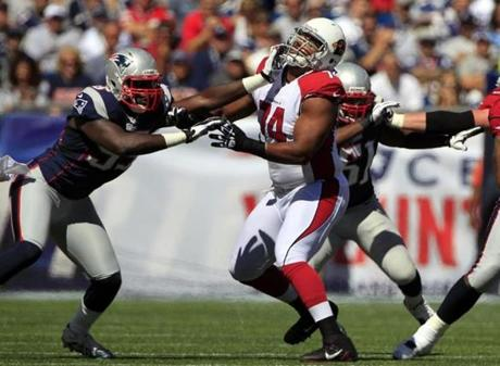 Patriots defensive end Chandler Jones pushed Cardinals tackle D'Anthony Batiste out of his way during the first quarter.