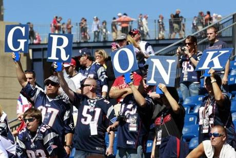 Fans cheer for Patriots tight end Rob Gronkowski before the game against the Cardinals.