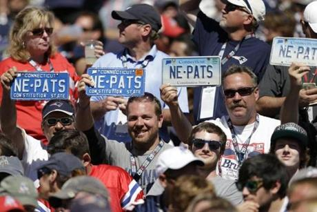 Fans hold Connecticut license plates supporting their team in the second quarter.