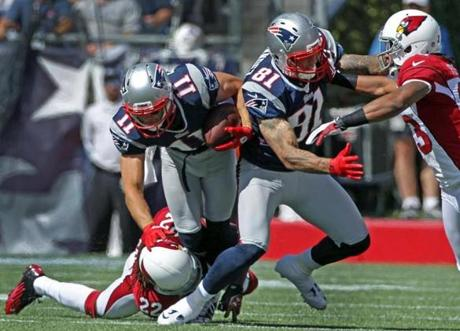Patriots tight end Aaron Hernandez was injured on this the play in the first quarter.