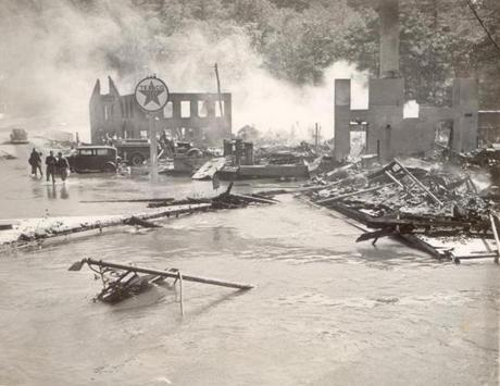 September 22, 1938:  Buildings owned by the Transcript Printing Company of Peterborough, N.H. were gutted by fire as fireman stood helpless in flood waters from the hurricane that swirled about the buildings. The town was badly hit by flooding from the Contoocook River. Peterborough was one of the worst hit New Hampshire communities, reachable only by airplane for several days.