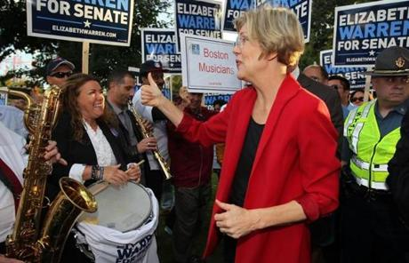 Warren greeted supporters before entering the studio.