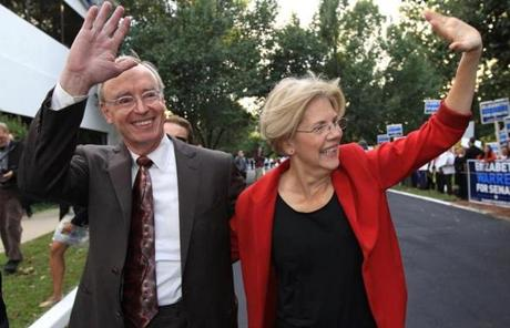 Warren was accompanied by her husband, Bruce Mann.